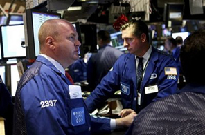 Specialists work on the trading floor of the New York Stock Exchange Tuesday, Sept. 8, 2009. Source: AP