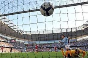 Manchester City score a goal during the English Premier League match against Arsenal at The City of Manchester Stadium in September. England's troubled bid to stage the 2018 World Cup received a boost when the Premier League announced a host of measures to revive the spluttering campaign. Source: AFP/File/Andrew Yates