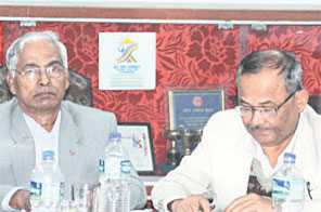 Youth and Sports Minister Ganesh Nepali (left)and NSC Member Secretary Hari Babu Chaudhary during the 70th NSC board meeting on Friday. Source: THT