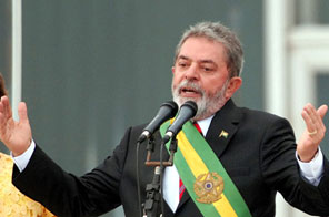 FILE - Brazil's President Luiz Inacio Lula da Silva looks up during a ceremony at the headquarters of the Ministry of Justice, in Brasilia, in this Jan. 26, 2010 file photo. Brazil's president was hospitalized overnight Thursday Jan. 28, 2010 because of high blood pressure — forcing him to cancel a trip to Switzerland to attend the World Economic Forum. A statement from the presidency issued Thursday said Silva received treatment overnight at a Recife hospital and passed the night comfortably. Silva had been set to receive a new 'Global Statesmanship Award' at the forum. Source: AP