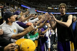Pau Gasol of the Los Angeles Lakers high fives fans. Gasol scored 29 points with 15 rebounds as the Los Angeles Lakers - with Kobe Bryant looking on - secured home court advantage through the NBA Western Conference playoffs with a 97-88 win over Minnesota Source: AFP