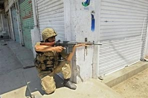 A Pakistani army soldier on patrol in Mingora, capital of the country's troubled northwest Swat valley. Source: AFP