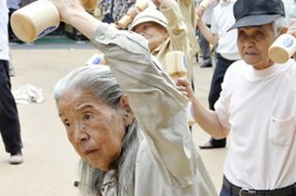Elderly people work out with wooden dumb-bells in the grounds of a temple in Tokyo in 2009. Asia's tradition of supporting elderly parents is under strain as waning filial piety, rising individualism and a change in attitudes towards marriage force the aged to seek support elsewhere, experts said Monday. Source: AFP