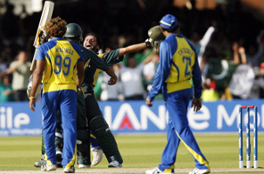 Shahid Afridi (C, back) celebrates with Shoaib Malik of Pakistan after winning their match against Sri Lanka during the ICC Twenty20 Cricket World Cup final at Lords in London on June 21, 2009. Pakistan won their first major title in 17 years when they stunned Sri Lanka by eight wickets in the World Twenty20 final at a sell-out Lord's.  Source: AFP PHOTO/Glyn Kirk