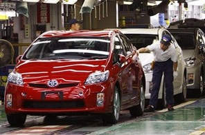 In this photo taken on June 5, 2009, a Toyota Motor Corp. worker gives the final examination on an newly assembled Prius at Toyota Tsutsumi Plant in Toyota, central Japan. Source: AP