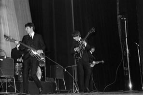 The Beatles perform in 1964 at the Olympia in Paris. US online music service Bluebeat said it plans to fight British recording label EMI over rights to stream and sell versions of Beatles songs. Source: AFP