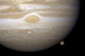 In this 2008 image released by NASA, the Hubble Space Telescope has caught Jupiter and its moon Ganymede (bottom right).  Source: AFP