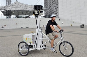 A French student employed by Google France, rides a tricycle fitted with cameras as part of the Google Street View project, in the financial district of La Defense, near Paris, in August. Switzerland's data protection commissioner has announced he is taking Google to court in a dispute over privacy concerns on the US Internet giant's