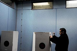 A Kosovo Serb prepares his vote at a polling station in Gracanica. Kosovo citizens went to the polls Sunday for the first time since the ethnic Albanian majority declared independence from Serbia in February 2008.  Source: AFP