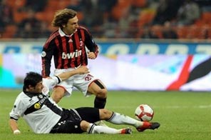 AC Milan's midfielder Andrea Pirlo (right) struggles for control of the ball with Parma's midfielder Julio Cesar Leon in Milan on October 31. AC Milan are set to clash with Real Madrid in a Champions League match. Source: AFP