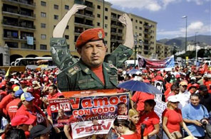 Supporters of the Venezuela's President Hugo Chavez hold up a image of him during a demonstration against Colombia's President Alvaro Uribe in Caracas, Saturday, Nov. 21, 2009. Source: AP