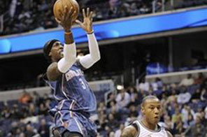 Charlotte Bobcats forward Gerald Wallace, left, goes to the basket against Washington Wizards forward Caron Butler during the first half of an NBA basketball game, Saturday, Nov. 28, 2009, in Washington. Source: AP