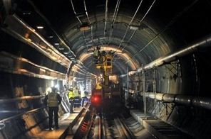 Workers repair part of the Channel TUnnel which links Britain and France in Coquelles, northern France earlier this year. Source: AFP