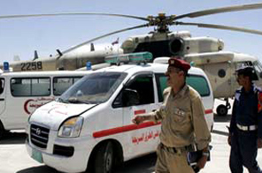 Ambulances wait for the arrival of the bodies of three women aid workers being flown in on a military helicopter to the Yeman capital San'a on Wednesday Source: