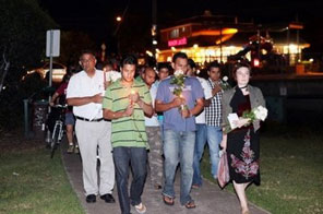 People take part in a candle light vigil in the western suburbs of Melbourne where Indian student Nitin Garg was fatally stabbed. Australia on Monday