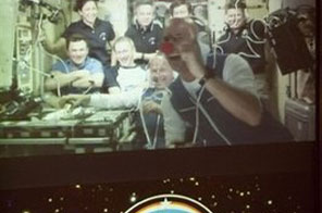 NASA photo shows Guy Laliberte in the foreground onboard the International Space Station. A Russian Soyuz capsule carrying the Canadian circus tycoon has reportedly undocked from the ISS and taken course for Earth. Source: AFP