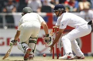 South Africa's AB de Villiers, left, survives a run out attempt from England's Alistair Cook, right, on the third day of their fourth test cricket match against England in Johannesburg, South Africa, Saturday, Jan. 16, 2010. Source: AP