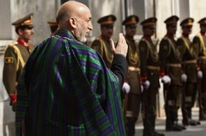 Afghan President Hamid Karzai and an honour guard greet United Nations Secretary General Ban Ki-moon at the Presidential Palace in Kabul on November 2. US President Barack Obama signaled a tough new approach to Karzai urging him just hours after his re-election to wipe out corruption amid warnings of hard talks ahead. Source: AFP