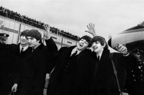 File picture from 1964 shows the Beatles, from left John Lennon, Ringo Starr, Paul McCartney and George Harrison, arriving in New York. A judge Thursday ordered a California online music service to stop delivering Beatles songs to users, according to a copy of the ruling posted online. Source: AFP/File