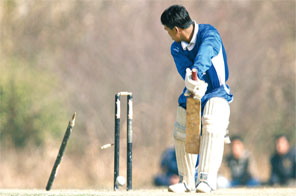 Bhawendra Magar of Biratnagar looks at his stumps rattled down by Birendra Bista of Baitadi during their Boost Under-16 National Cricket League match in Pulchowk Engineering Campus on Friday. Source: Udipt Chhetry