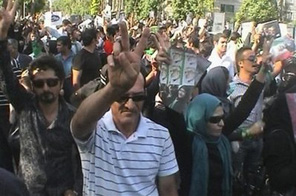 In this frame grab taken from amateur video, supporters of Iranian reformist opposition leader Mir Hossien Mousavi demonstrate in Tehran, Iran, Tuesday June 16, 2009. Source: AP