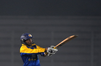 Sri Lankan cricketer Tillakaratne Dilshan plays a shot during the Tri-Nation Tournament at The Sher-e Bangla National Stadium in Dhaka on January 4, 2010. Sri Lanka are currently at 30 runs for the loss of no wickets as they chase the Bangladesh score of 260. Source: AFP