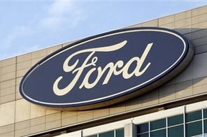 In this Oct. 26, 2009 photo, the Ford logo is seen on the automaker's headquarters in Dearborn, Mich. Workers at two more United Auto Workers locals overwhelmingly rejected changes to their contract with Ford Motor Co. on Thursday Oct. 29, 2009, casting further doubt on whether the deal will be approved. Source: AP