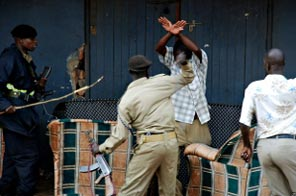 Ugandan police beat a man during disturbances in the Natete suburb of Kampala on September 11, 2009. Source: AFP