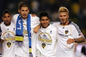 (L-R) Sean Franklin, Omar Gonzalez, A.J. DeLaGarza and David Beckham look on from the podium after defeating the Houston Dynamo 2-0 in the MLS Western Conference Championship match at The Home Depot Center in Carson, California. Source: AFP
