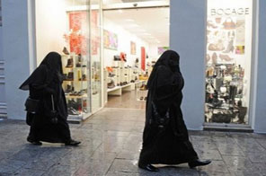 Women wearing the full islamic veil are seen shopping in Marseille. France was set to move one step closer to barring Muslim women from wearing the full Islamic veil with the release Tuesday of a report calling for a ban on the burqa in public institutions. Source: AFP