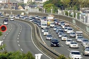 A traffic jam snakes its way through Tokyo. Source: AFP