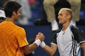 Nikolay Davydenko of Russia (R) and Novak Djokovic of Serbia shake hands following Davydenko's victory in their semi-final match at the ATP Masters tennis tournament in Shanghai on October 17, 2009. Davydenko won 4-6, 6-4, 7-6 (7/1). Source:  AFP