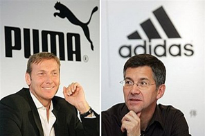 This combo photo shows the CEO of German sportswear company Puma Jochen Seitz (L) and Adidas CEO Herbert Hainer. Source: AFP