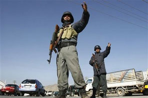 Afghan soldiers secure a street in Kabul, Afghanistan, Thursday, Nov. 19, 2009. The Afghan capital was put under heavy security Thursday for the inauguration of Afghan President Hamid Karzai. Source: AP