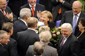 German lawmakers have formally re-elected Angela Merkel for a second four-year term as chancellor, this time at the head of a new centre-right coalition. Source: AFP