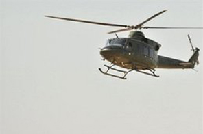 A helicopter hovers over a Pakistani soldier after the attack on the entrance of army headquarters in Rawalpindi on October 10. Source: AP