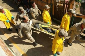 Rescue workers recover the body of a landslide victim in Praia do Bananal, Ilha Grande, southwest of Rio de Janeiro, Brazil, on January 2. Two nuclear plants close to a southern Brazilian town hit by landslides may shut down as a precaution, the mayor said, as the regional toll from deadly floods rose to 68. Source: AFP