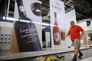 A worker walks in front of posters during preparation for the international wine fair Vinexpo in Bordeaux, southwestern France, on June 18, 2009. Vinexpo, the world's biggest wine and spirits fair which start on June 21 is a worldwide benchmark event that brings together all players in the wine and spirits industry. Source: AFP