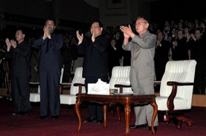 Undated picture, released by North Korea's official Korean Central News Agency shows North Korean leader Kim Jong-Il (R) attending a performance by the Mansudae Art Troupe. Kim has hosted a dinner party for the new Chinese ambassador to North Korea, state media said Sunday, amid reports the reclusive leader was set to visit Beijing Source: AFP