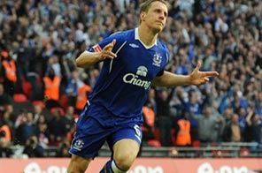 Everton's English defender Phil Jagielka celebrates after scoring the winning penalty in the FA Cup Semi-Final at Wembley Stadium in London in April. Everton's defender could be sidelined until January after undergoing a second knee operation, the Premier League side has revealed. Source: AFP