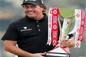 Phil Mickelson of the U.S. holds the trophy after winning the HSBC Champions golf tournament at Shanghai Sheshan International Golf Club Sunday, Nov. 8, 2009 in Shanghai, China. Mickelson finished at 17-under 271. Source: Agencies