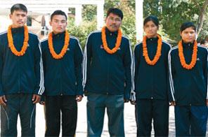 (From left) Athletes Tilak Ram Mahato,Hari Kumar Rimal,coach Jitendra Chaudhary,Keshari Chaudhary and Pramila Rijal in Kathmandu on Friday,before their departure to Guangzhou,China to take part in the 18th Asian Athletics Championship Source: The Himalan Times