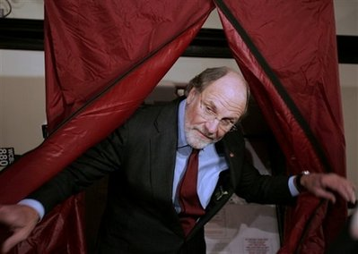 New Jersey Gov. Jon Corzine emerges from the booth after voting at the Elks Club in Hoboken, N.J., Tuesday, Nov. 3, 2009. The governor is running for a second term against Republican candidate Chris Christie and Independent candidate Chris Daggett. Source: AP