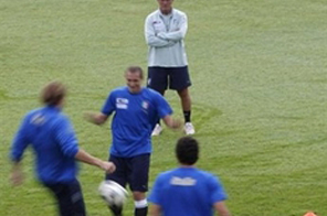 Italy's national football coach Marcello Lippi (back) watches his players during a training session on October 7, 2009 at the national technical center of Coverciano, near Florence. Source: AFP