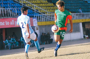 Saroj Basnet of MMC and Anil Sharma of PLA Sports Club (right) vie for the ball during the British Gurkha Cup Football Tournament Group 'C'match at the Dasharath Stadium in Kathmandu on Sunday. Source: Rajendra Manandhar