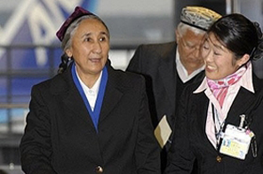 Exiled Uighur leader Rebiya Kadeer (L) arrives at the Narita International airport, near Tokyo. Source: AFP