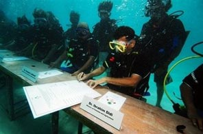 Maldives Presidency issued photo shows members of the Indian Island nation's government undertaking an underwater cabinet meeting. The Maldives, which is one of the nations most vulnerable to rising sea levels, has asked fellow endangered states to go carbon neutral and lead a drive to reduce global warming. Source: AFP
