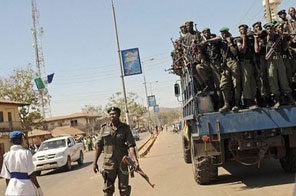 File photo shows anti-riot police on patrol in Jos, Nigeria. Thousands of troops remained on the streets of the Nigerian city of Jos on Thursday to quell clashes between Christian and Muslim mobs that has left about 300 dead. Source: AFP