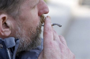 A man smokes a cigarette in Belfast, northern Ireland.  Source: AFP