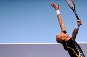 Nikolay Davydenko of Russia celebrates after defeating Juan Martin Del Potro of Argentina in the singles final match during the Barclays ATP World Tour Tennis Finals in London. Davydenko won with a straight sets victory. Source: AFP